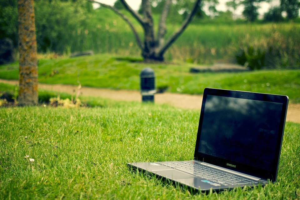 Laptop computer on grass | Home inspection website | The Savvy Inspector